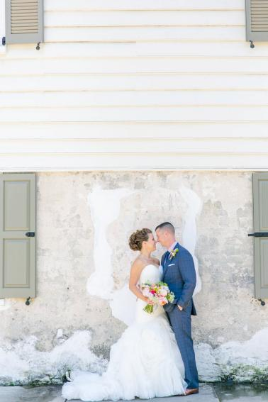 A Pink, Orange, & White Intimate Charleston Destination Wedding via TheELD.com