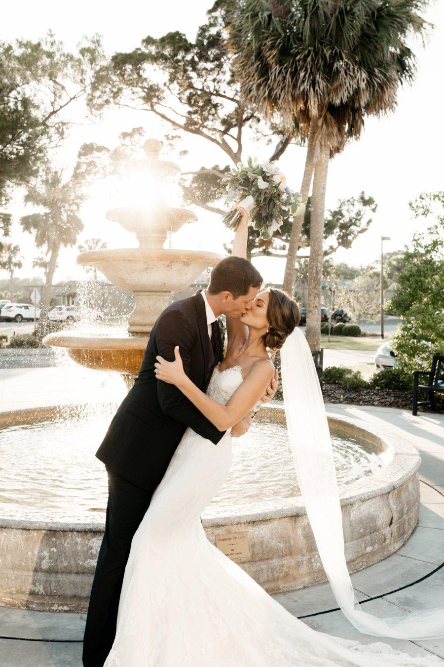 A White & Green Waterfront Florida Wedding via TheELD.com