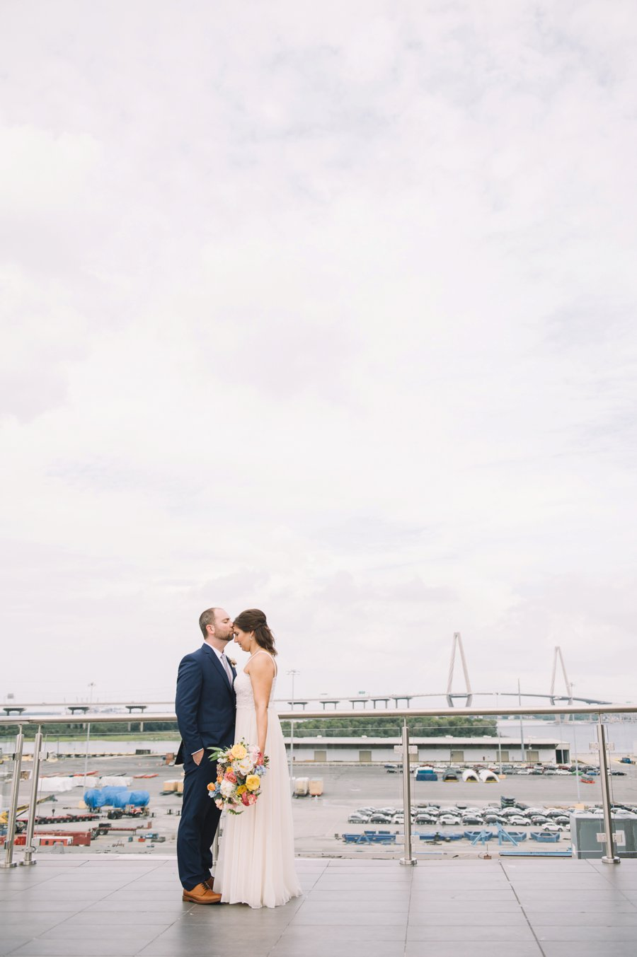 An Elegant Industrial Yellow, Grey, & Blue Charleston Wedding via TheELD.com