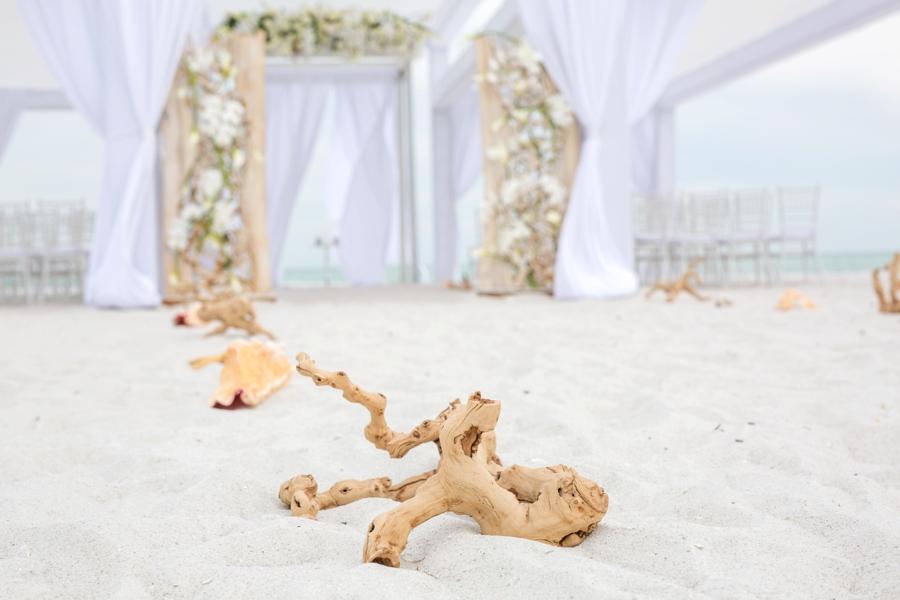 An Elegant & Luxe White Beach Wedding via TheELD.com